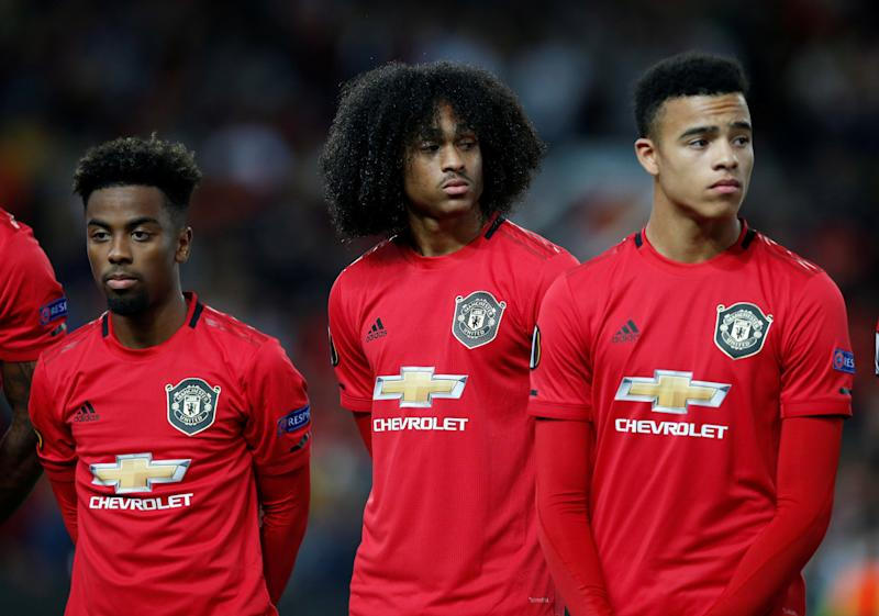 Soccer Football - Europa League - Group L - Manchester United v Astana - Old Trafford, Manchester, Britain - September 19, 2019 Manchester United's Angel Gomes, Tahith Chong and Mason Greenwood lined up before the match REUTERS/Andrew Yates
