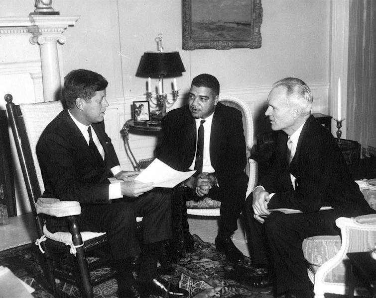 "This photo provided by the Kennedy Library, show eting with National Urban League officials. President Kennedy (in rocking chair) meeting with National Urban League Executive Director Whitney M. Young, center, and president Henry Steeger in the president's Living Room of the White House in Washington, on Jan. 23, 1962. Rep. John Lewis, D-Ga., tells the story of Young's boldness in dealing with civil rights issues in ""The Powerbroker: Whitney Young's Fight For Civil Rights"" a documentary airing during Black History Month on PBS' Independent Lens and shown in some community theaters. (AP Photo/The White House, Abbie Rowe, John F. Kennedy Presidential Library and Museum)"
