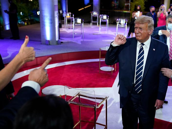 US president Donald Trump refused to denounce QAnon at NBC Town Hall on Thursday (AP)