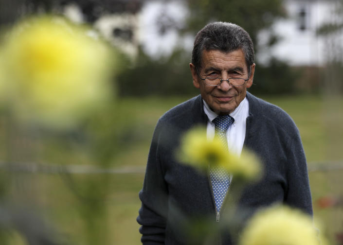 Human rights lawyer Geoffrey Nice walks through his garden at his home in Adisham, England, Wednesday, Sept. 2, 2020. The prominent British human rights lawyer is convening an independent tribunal in London with public hearings next year, to look into the Chinese government's alleged rights abuses against the Uighur Muslim minority in the far western province of Xinjiang.(AP Photo/Frank Augstein)