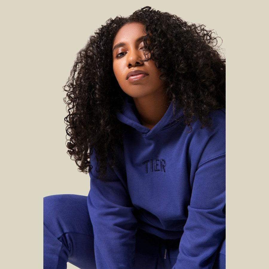 "<p>Sweatsuits have never felt more necessary than this year. The elevated French Terry Tier Sweatsuit Hoodie and Pants in deep blue is a comfortably <a href=""https://www.allure.com/gallery/best-pajamas-at-every-price-point?mbid=synd_yahoo_rss"" rel=""nofollow noopener"" target=""_blank"" data-ylk=""slk:sleek loungewear look"" class=""link rapid-noclick-resp"">sleek loungewear look</a> that will become their go-to stay-at-home uniform. You may even want to treat yourself to a set, too. </p> <p><strong>$150 for the hoodie</strong> (<a href=""https://www.shoptier.nyc/shop-1/blue-depths-tir-hoodie"" rel=""nofollow noopener"" target=""_blank"" data-ylk=""slk:Shop Now"" class=""link rapid-noclick-resp"">Shop Now</a>) and <strong>$140 for the pants</strong> (<a href=""https://www.shoptier.nyc/shop-1/blue-depths-tir-sweatpants"" rel=""nofollow noopener"" target=""_blank"" data-ylk=""slk:Shop Now"" class=""link rapid-noclick-resp"">Shop Now</a>)</p>"