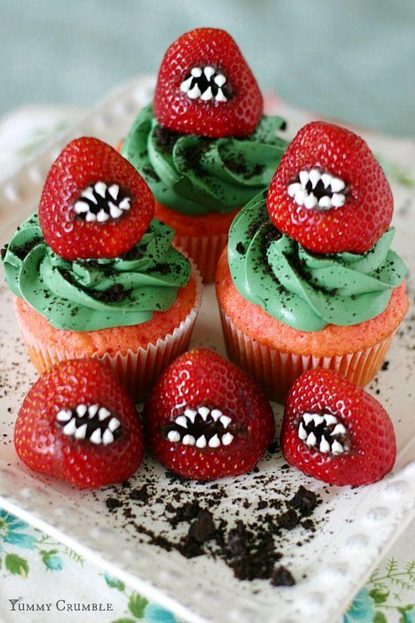 """<p>Rows of sharp """"teeth"""" add a scary touch to a sweet dessert. </p><p><strong>Get the recipe at </strong><strong><a href=""""http://yummycrumble.com/monster-strawberry-cupcakes/"""" rel=""""nofollow noopener"""" target=""""_blank"""" data-ylk=""""slk:Yummy Crumble"""" class=""""link rapid-noclick-resp"""">Yummy Crumble</a>.</strong></p><p><strong><strong><strong><a class=""""link rapid-noclick-resp"""" href=""""https://www.amazon.com/Wilton-Non-Stick-Muffin-Cupcake-Baking/dp/B00KIFBI1C/?tag=syn-yahoo-20&ascsubtag=%5Bartid%7C10050.g.1366%5Bsrc%7Cyahoo-us"""" rel=""""nofollow noopener"""" target=""""_blank"""" data-ylk=""""slk:SHOP CUPCAKE TINS"""">SHOP CUPCAKE TINS</a></strong></strong></strong></p>"""