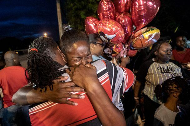 PHOTO: Chanese Sneed, the mother of Noah Sneed hugs Noah's father Tony Bell during a gathering to honor his life with a candlelight memorial in front of the Ceressa's Daycare & Preschool Center, July 30, 2019, in Oakland Park, Fla. (Michael Laughlin/Sun Sentinel/TNS via Getty Images)