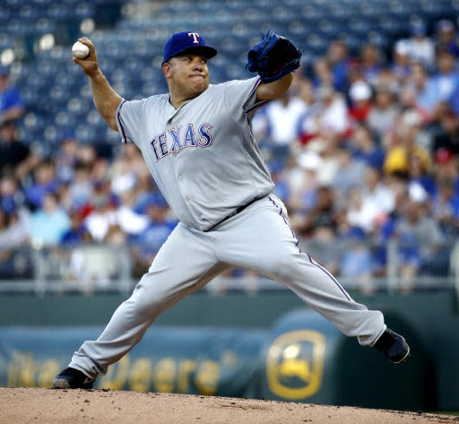 Texas Rangers starting pitcher Bartolo Colon throws during the first inning of a baseball game against the Kansas City Royals Monday, June 18, 2018, in Kansas City, Mo. (AP Photo/Charlie Riedel)