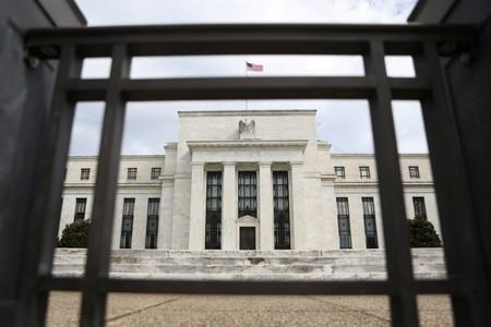U.S.-China trade war risks driving Fed policy, not Trump's carping - economists