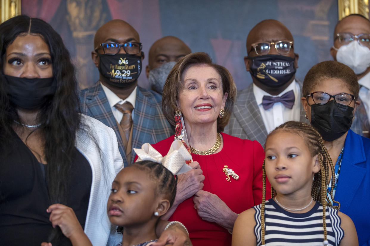 House Speaker Nancy Pelosi poses for a photo with George Floyd's family and members of Congress Tuesday. (Shawn Thew/Pool via AP)
