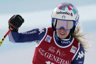 Italy's Marta Bassino reacts at finish line after completing an alpine ski women's World Cup Super G in Val d'Isere, France, Sunday, Dec. 20, 2020. (AP Photo/Giovanni Auletta)