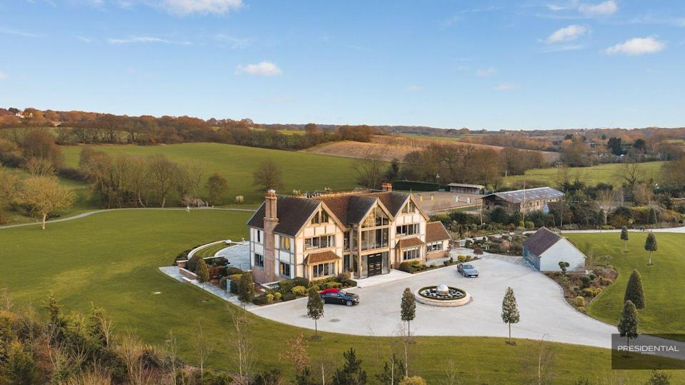 "<p>This sprawling five-bedroom house can be found deep in the Essex countryside, set within an excess of 52 acres of private land. All five bedrooms have <a href=""https://www.housebeautiful.com/uk/decorate/bedroom/a30966899/walk-in-wardrobe-ideas/"" rel=""nofollow noopener"" target=""_blank"" data-ylk=""slk:walk-in wardrobes"" class=""link rapid-noclick-resp"">walk-in wardrobes</a> and en-suites, and it has its own Olympic-sized equestrian centre. The enormous mansion also boasts an impressive underground car port, big enough to accommodate a fleet of 10 supercars! If that wasn't enough, the property is also home to an indoor swimming pool, complete with a waterfall and jacuzzi, as well as a sauna, steam room, cinema room, and a home gym. </p><p><a class=""link rapid-noclick-resp"" href=""https://www.rightmove.co.uk/properties/70432788#/"" rel=""nofollow noopener"" target=""_blank"" data-ylk=""slk:TOUR NOW"">TOUR NOW</a></p><p><strong>Like this article?<a href=""https://hearst.emsecure.net/optiext/cr.aspx?ID=DR9UY9ko5HvLAHeexA2ngSL3t49WvQXSjQZAAXe9gg0Rhtz8pxOWix3TXd_WRbE3fnbQEBkC%2BEWZDx"" rel=""nofollow noopener"" target=""_blank"" data-ylk=""slk:Sign up to our newsletter"" class=""link rapid-noclick-resp"">Sign up to our newsletter</a> to get more articles like this delivered straight to your inbox.</strong></p><p><a class=""link rapid-noclick-resp"" href=""https://hearst.emsecure.net/optiext/cr.aspx?ID=DR9UY9ko5HvLAHeexA2ngSL3t49WvQXSjQZAAXe9gg0Rhtz8pxOWix3TXd_WRbE3fnbQEBkC%2BEWZDx"" rel=""nofollow noopener"" target=""_blank"" data-ylk=""slk:SIGN UP"">SIGN UP</a></p>"