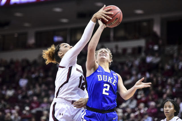 Duke guard Haley Gorecki (2) has a shot blocked by South Carolina guard Breanna Beal (12) during the first half of an NCAA college basketball game Thursday, Dec. 19, 2019, in Columbia, S.C. (AP Photo/Sean Rayford)