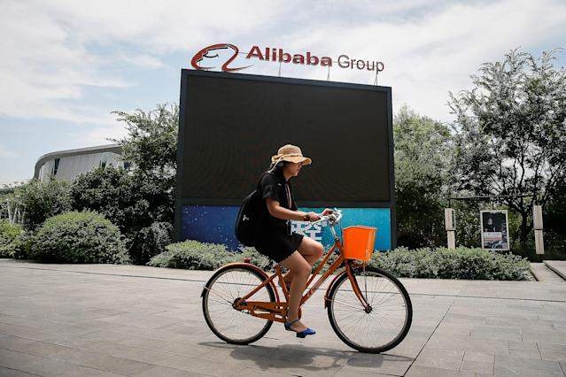 Alibaba wants to take on Tencent's ecosystem. (Photo by Wang He/Getty Images)