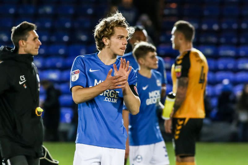 Bobby Copping acknowledges the supporters at full-time after making his Peterborough United debut at Weston Homes Stadium