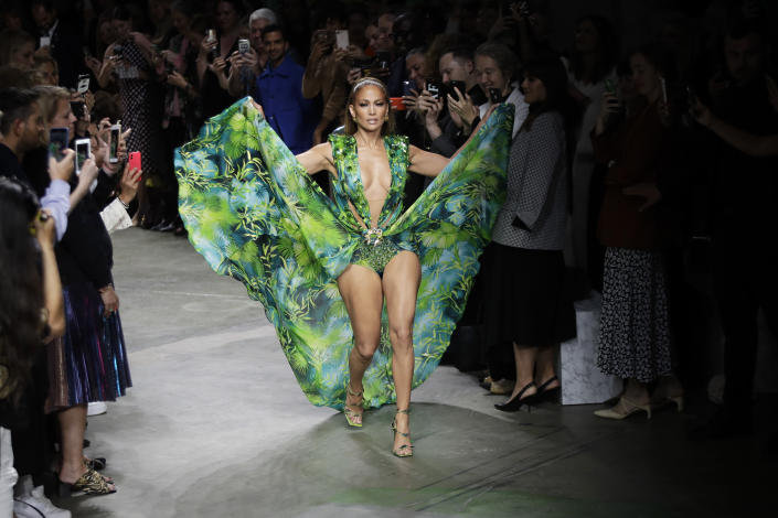 Jennifer Lopez wears a creation as part of the Versace Spring-Summer 2020 collection, unveiled during the fashion week, in Milan, Italy, on Sept. 20, 2019. (AP Photo/Luca Bruno)