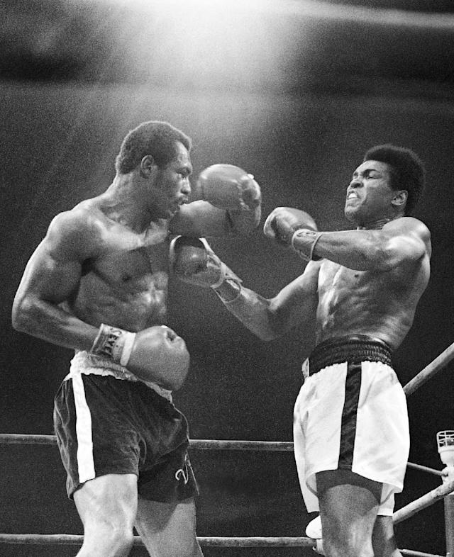 FILE - In this Sept. 10, 1973, file photo, Muhammad Ali, right, winces as Ken Norton hits him with a left to the head during their re-match at the Forum in Inglewood, Calif. Norton, a former heavyweight champion, has died, his son said, Wednesday, Sept. 18, 2013. He was 70. (AP Photo/File)