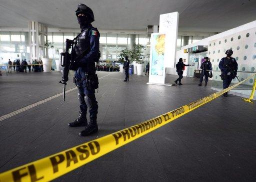 Police stand guard outside Mexico City's airport after a shooting incident killed three officers