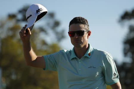 Justin Rose of England waves on the 18th after finishing his third round play during the 2017 Masters golf tournament at Augusta National Golf Club in Augusta, Georgia, U.S., April 8, 2017. REUTERS/Brian Snyder