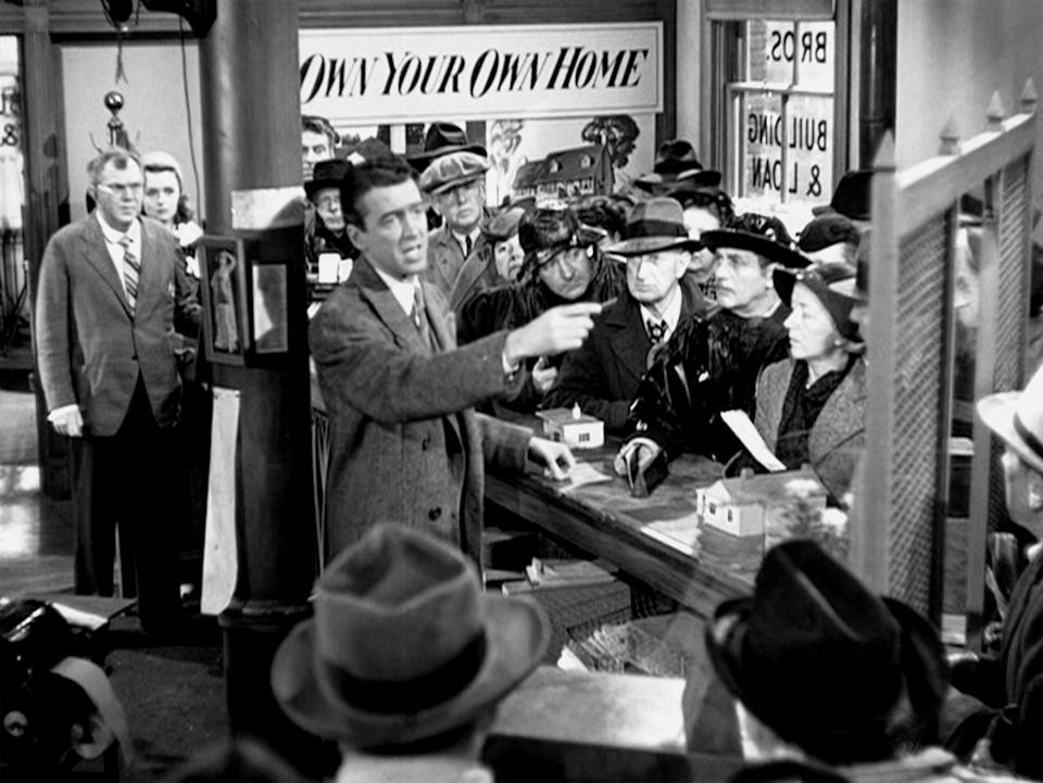 "LOS ANGELES - DECEMBER 20: The movie ""It's a Wonderful Life"", produced and directed by Frank Capra. Seen here in center, James Stewart as George Bailey trying to calm investors. Premiered December 20, 1946; theatrical wide release January 7, 1947. Screen capture. Paramount Pictures. (Photo by CBS via Getty Images)"