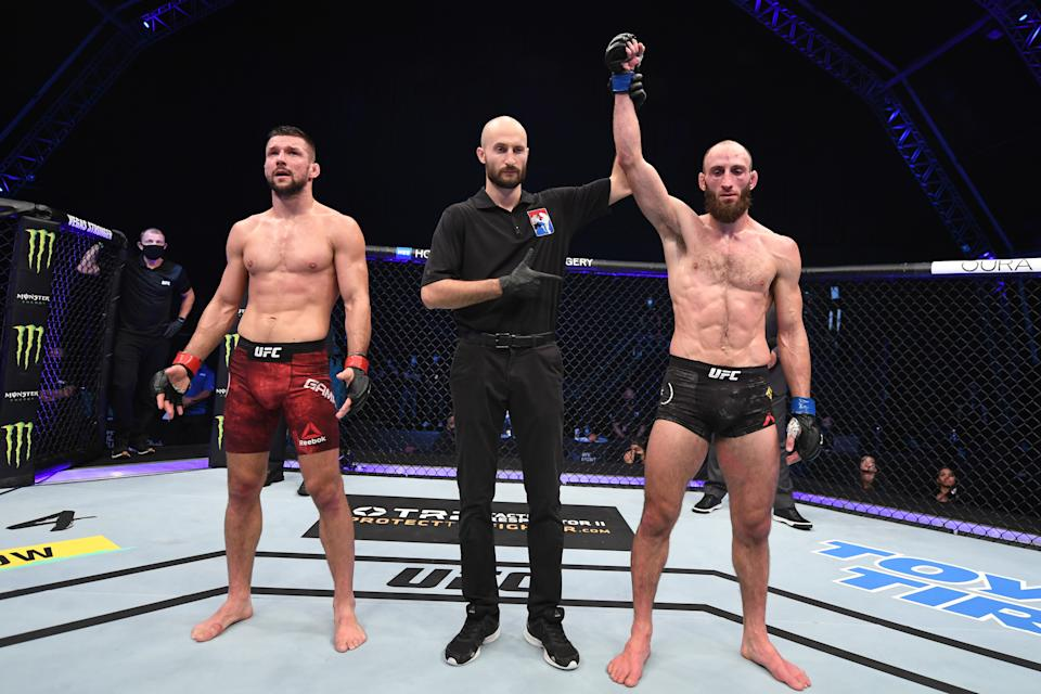 ABU DHABI, UNITED ARAB EMIRATES - OCTOBER 18:  (R-L) Guram Kutateladze of Georgia celebrates his victory over Mateusz Gamrot of Poland in their lightweight bout during the UFC Fight Night event inside Flash Forum on UFC Fight Island on October 18, 2020 in Abu Dhabi, United Arab Emirates. (Photo by Josh Hedges/Zuffa LLC via Getty Images)