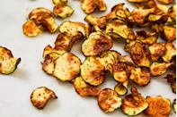 """<p>Cool ranch and football go hand-in-hand.</p><p>Get the recipe from <a href=""""https://www.delish.com/cooking/recipe-ideas/a22344312/cool-ranch-zucchini-chips/"""" rel=""""nofollow noopener"""" target=""""_blank"""" data-ylk=""""slk:Delish"""" class=""""link rapid-noclick-resp"""">Delish</a>.</p>"""