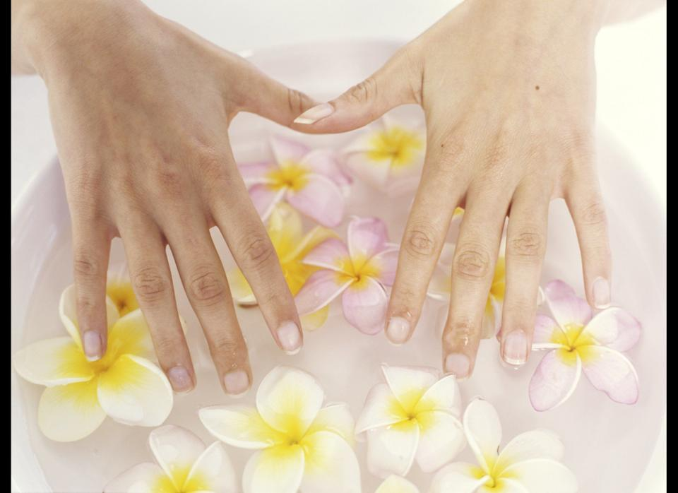 """Making time for a manicure? Bring along your own polish and tools to the nail salon so you know they're sanitary, suggests Dr. Wu, since if not properly cleaned, manicure instruments can expose you to infection-causing bacteria. Next, ask your manicurist not to cut your cuticles.     The reason: """"Cuticles are there to protect the nails and keep bacteria and fungus from getting underneath your skin, so there should be a tight seal between your cuticle and your nail,"""" Dr. Wu says.     Doing an at-home manicure? Look for a nail polish remover without formaldehyde -- this chemical can dry out your nails and skin, spurring painful splits, says Dr. Wu. Lastly, to combat cracks and dry cuticles, she suggests sweet almond oil. It's high in emollient, skin-saving omega-3 fatty acids, so it won't wash away with soap and water."""