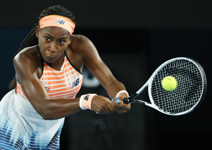 United States' Coco Gauff makes a backhand return to Ukraine's Elina Svitolina during their second round match at the Australian Open tennis championship in Melbourne, Australia, Thursday, Feb. 11, 2021.(AP Photo/Rick Rycroft)
