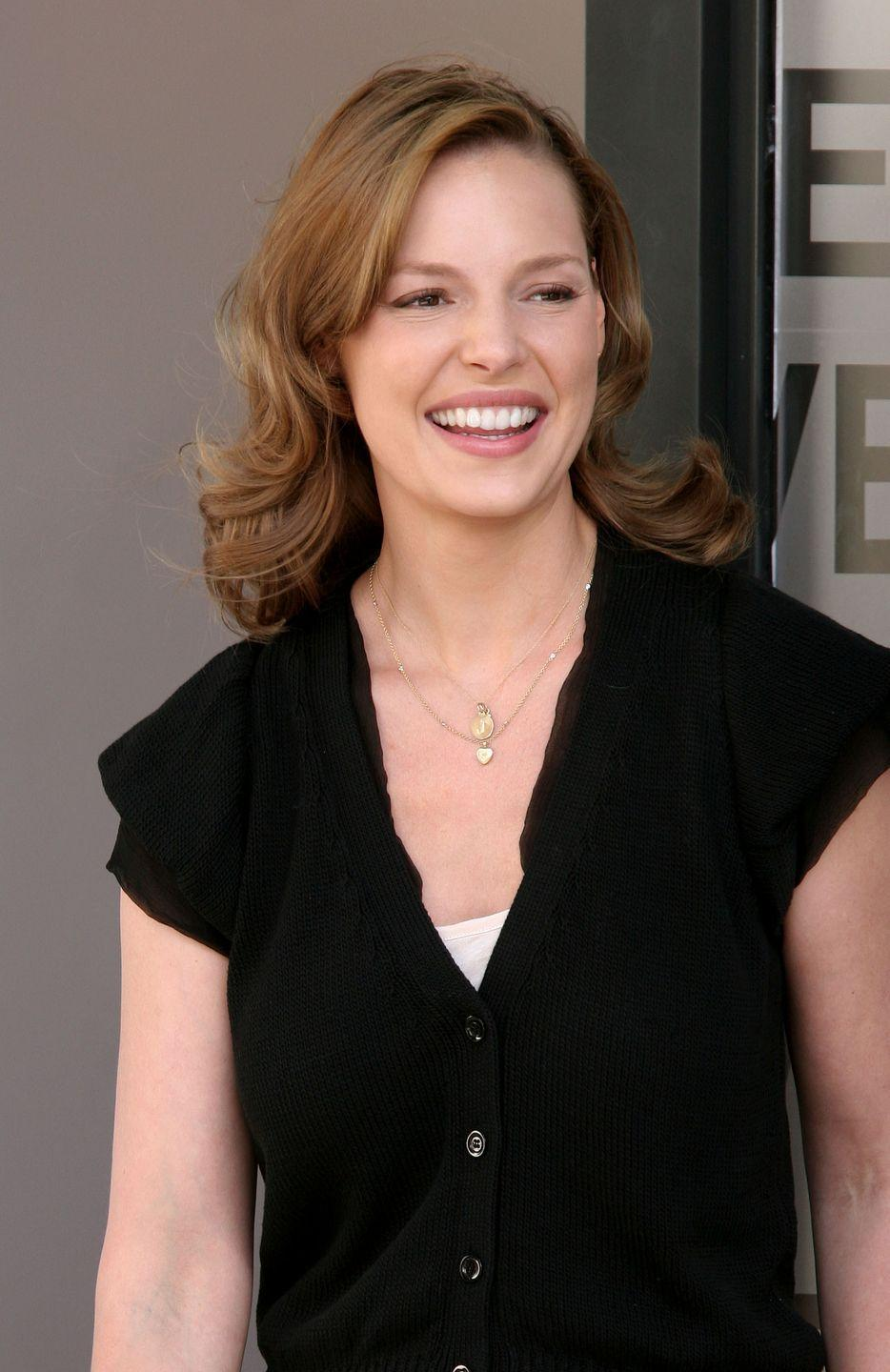 """<p>While she was filming the iconic wedding film <em>27 Dresses</em>, Katherine Heigl was also planning her real-life wedding. That included straightening out two teeth that stuck out. </p><p>She opted for Invisalign, which caused some difficulties on set. """"All my life, I've had two teeth that stuck out, and I'd been fine with it in my film career. But, for my wedding, I wasn't OK with it,"""" <a href=""""https://www.peoplemagazine.co.za/celebrity-news/international-celebrities/katherine-heigl-opens-up-about-27-dresses-dental-drama/"""" rel=""""nofollow noopener"""" target=""""_blank"""" data-ylk=""""slk:she said at the time"""" class=""""link rapid-noclick-resp"""">she said at the time</a>. """"So I got Invisalign (braces) and I remember when we were filming, I was always having to take them out to do my dialogue or do a scene.""""</p>"""