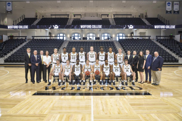 This photo provided by Wofford College shows the 2018-19 Wofford NCAA men's college basketball team. Seated from left are: Fletcher Magee, Ryan Larson, Tray Hollowell, Storm Murphy, Nathan Hoover, Donovan Theme-Love, Messiah Jones and Drew Cottrell. Standing from left are: Assistant coach Kevin Giltner, head coach Mike Young, associate head coach Jay McAuley, athletic trainer Alyss Hart, Alex Michael, Isaiah Bigelow, Cameron Jackson, Michael Manning, Jr., Matt Pegram, Chevez Goodwin, Kevin Aluma, Trevor Stumpe, assistant coach Will Murphy, athletic performance coach David Land, student manager Clarke Allen, student manager Will Stigall and manager Gordon Rodgers. (Marl Olencki/Wofford College via AP)