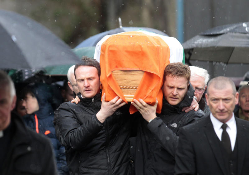 Emmett and Fiachra McGuinness carry the coffin of their father Martin through the bogside area of Londonderry, Northern Ireland, Tuesday, March, 21, 2017. Martin McGuinness, the Irish Republican Army warlord who led his underground, paramilitary movement toward reconciliation with Britain, and was Northern Ireland's deputy first minister for a decade in a power-sharing government, has died, his Sinn Fein party announced Tuesday on Twitter. He was 66.(AP Photo/Peter Morrison)
