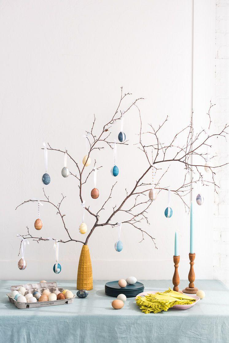 """<p>Bring the charm of the great outdoors (minus the mess) into your living room by building your own <a rel=""""nofollow noopener"""" href=""""https://www.countryliving.com/diy-crafts/g26498744/easter-tree/"""" target=""""_blank"""" data-ylk=""""slk:thematic mini tree"""" class=""""link rapid-noclick-resp"""">thematic mini tree</a>. Adorn with your best <a rel=""""nofollow noopener"""" href=""""https://www.countryliving.com/diy-crafts/g26810304/how-to-dye-easter-eggs/"""" target=""""_blank"""" data-ylk=""""slk:dyed eggs"""" class=""""link rapid-noclick-resp"""">dyed eggs</a> for the finishing staple. </p><p><strong>Get the tutorial at <a rel=""""nofollow noopener"""" href=""""https://thehousethatlarsbuilt.com/2018/03/naturally-dyed-easter-egg-tree.html/#more-31813"""" target=""""_blank"""" data-ylk=""""slk:The House That Lars Built"""" class=""""link rapid-noclick-resp"""">The House That Lars Built</a>. </strong></p><p><strong><a rel=""""nofollow noopener"""" href=""""https://www.amazon.com/White-ribbon-Thick-Yards-Ribbons/dp/B01M7ZA20R/"""" target=""""_blank"""" data-ylk=""""slk:SHOP RIBBON"""" class=""""link rapid-noclick-resp"""">SHOP RIBBON</a></strong></p>"""