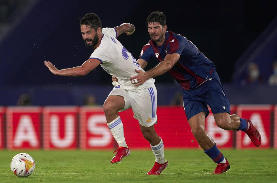 VALENCIA, SPAIN - AUGUST 22: Gonzalo Melero of Levante UD competes for the ball with Isco Alarcon of Real Madrid during the La Liga Santander match between Levante UD and Real Madrid CF at Ciutat de Valencia Stadium on August 22, 2021 in Valencia, Spain. (Photo by Quality Sport Images/Getty Images)