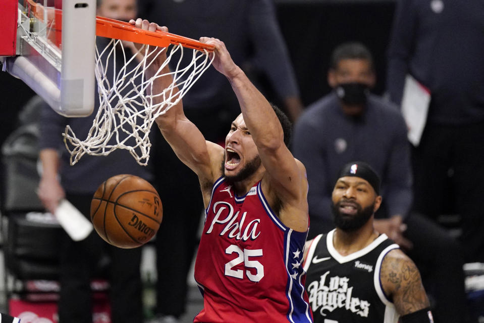 Philadelphia 76ers guard Ben Simmons, left, dunks as Los Angeles Clippers forward Marcus Morris Sr. watches during the second half of an NBA basketball game Saturday, March 27, 2021, in Los Angeles. The Clippers won 122-112. (AP Photo/Mark J. Terrill)