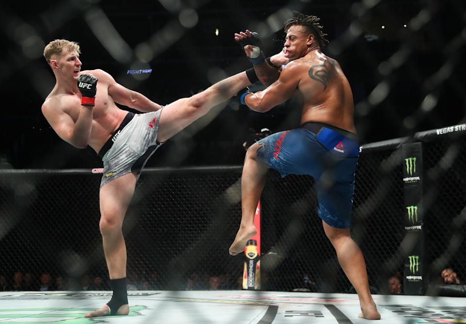 MOSCOW, RUSSIA  NOVEMBER 10, 2019: UFC heavyweight fighters Greg Hardy (R) of the United States and Alexander Volkov of Russia in a bout as part of the UFC Fight Night 163 mixed martial arts event, at CSKA Arena. Valery Sharifulin/TASS (Photo by Valery Sharifulin\TASS via Getty Images)