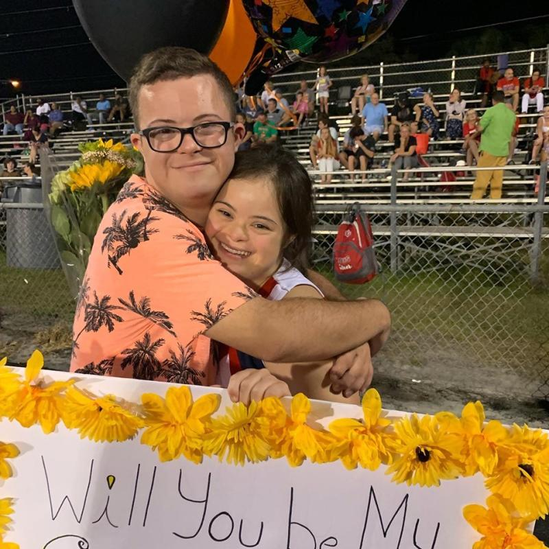 In a viral video, David Matthew Cowan asks his girlfriend, both of whom have Down syndrome, to homecoming at a high school football game. (Credit: Saris Maria Garcia/Facebook)