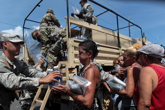 <p>Soldiers of Puerto Rico's national guard distribute relief items to people, after the area was hit by Hurricane Maria in San Juan, Puerto Rico September 24, 2017. (Photo: Alvin Baez/Reuters) </p>