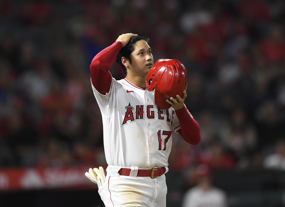 ANAHEIM, CA - SEPTEMBER 24: Shohei Ohtani #17 of the Los Angeles Angels walks to first base after getting a walk during the event inning against the Seattle Mariners at Angel Stadium of Anaheim on September 24, 2021 in Anaheim, California. (Photo by Kevork Djansezian/Getty Images)