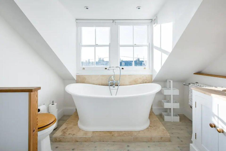 """<p>Head for one of the coolest seaside towns in the UK where oysters and beach strolls await, and check into a fabulous beach retreat for six. Families or friends will love this perfectly placed Airbnb tucked away behind vibrant Harbour Street. The cosy rental boasts original fireplaces, whitewashed floorboards and a roll-top bathtub to help you melt away your stresses on a coastal escape in Kent.</p><p><strong>Sleeps: </strong>Six</p><p><a class=""""link rapid-noclick-resp"""" href=""""https://airbnb.pvxt.net/Vy476O"""" rel=""""nofollow noopener"""" target=""""_blank"""" data-ylk=""""slk:SEE INSIDE"""">SEE INSIDE</a> </p>"""