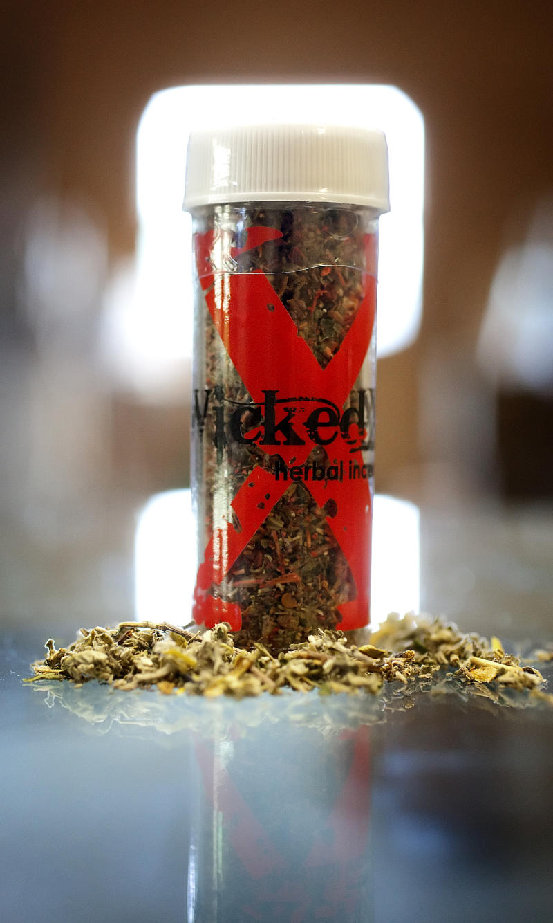 FILE - In this July 13, 2010, file photo a container of Wicked X, a synthetic marijuana, sits on a counter at Hemp's Above in Mechanicsburg, Pa. Synthetic substances that mimic marijuana, cocaine and other illegal drugs are making users across the nation seriously ill, causing seizures and hallucinations so intense that thousands of them seek help at emergency rooms. At the request of The Associated Press, the American Association of Poison Control Centers analyzed nationwide figures on calls related to synthetic drugs. The findings showed an alarming increase in the number of people seeking medical attention.  (AP Photo/The Patriot-News, Sean Simmers, File)