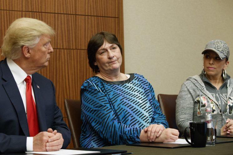 Donald Trump, left, and Paula Jones, right, look on as Kathy Shelton makes remarks in St. Louis. (Photo: Evan Vucci/AP)