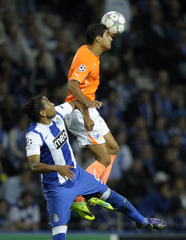 Apoel FC's Brazilian forward Ailton (R) heads the ball with FC Porto's Uruguayan defender Alvaro Pereira (R) during their UEFA Champions League Group G football match at the Dragao Stadium in Porto, on October 19, 2011. AFP PHOTO / MIGUEL RIOPA (Photo credit should read MIGUEL RIOPA/AFP/Getty Images)