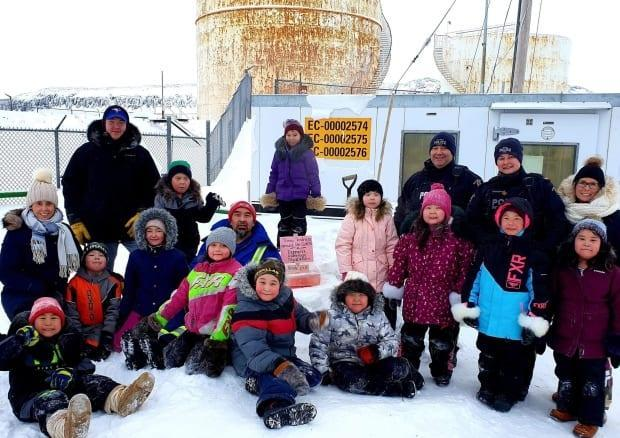 Students at  Helen Kalvak Elihakvik School in Ulukhaktok, N.W.T. crated pink signs with messages of kindness to celebrate Pink Shirt Day last week. Last Friday, with the help of their teachers and members of the RCMP, they posted the signs throughout the community. (Mackenzie Scott/CBC - image credit)