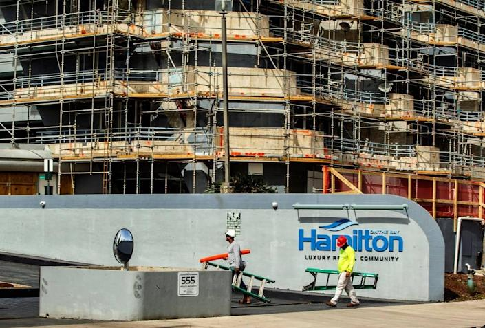Construction workers are seen at the Hamilton on the Bay on Friday, Aug. 27, 2021.