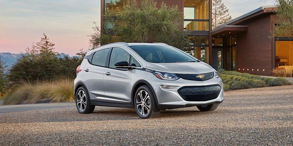 """<p>The <a href=""""https://www.caranddriver.com/chevrolet/bolt-ev-2021"""" rel=""""nofollow noopener"""" target=""""_blank"""" data-ylk=""""slk:2021 Chevy Bolt EV"""" class=""""link rapid-noclick-resp"""">2021 Chevy Bolt EV</a> isn't as interesting as the <a href=""""https://www.caranddriver.com/hyundai/kona-electric"""" rel=""""nofollow noopener"""" target=""""_blank"""" data-ylk=""""slk:Hyundai Kona Electric"""" class=""""link rapid-noclick-resp"""">Hyundai Kona Electric</a> or as sexy as the <a href=""""https://www.caranddriver.com/tesla/model-3"""" rel=""""nofollow noopener"""" target=""""_blank"""" data-ylk=""""slk:Tesla Model 3"""" class=""""link rapid-noclick-resp"""">Tesla Model 3</a>, but its smooth ride, roomy cabin, and popular standard features make it an appealing option to mainstream-brand shoppers. The Chevy has an EPA driving range of 259 miles, which is nothing to sneeze at, and its fast-charging capability allows it to replenish up to 100 miles of range in 30 minutes. Sure, the Bolt's design borders on dorky, and its interior quality doesn't qualify as premium despite a starting price close to $40,000 (before federal tax credits), but its electric motor sends 266 pound-feet of torque to the front wheels, providing zippy acceleration. We also appreciate its <a href=""""https://www.caranddriver.com/features/a23477930/electric-car-one-pedal-driving/"""" rel=""""nofollow noopener"""" target=""""_blank"""" data-ylk=""""slk:one-pedal driving"""" class=""""link rapid-noclick-resp"""">one-pedal driving</a> and satisfying-to-use hand-brake function.</p><p><a class=""""link rapid-noclick-resp"""" href=""""https://www.caranddriver.com/chevrolet/bolt-ev-2021"""" rel=""""nofollow noopener"""" target=""""_blank"""" data-ylk=""""slk:Review, Pricing, and Specs"""">Review, Pricing, and Specs</a></p>"""