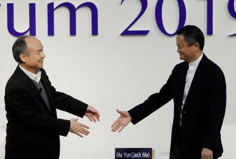 SoftBank Group founder and CEO Masayoshi Son and Alibaba founder and former Chairman Jack Ma attend the Tokyo Forum 2019 in Tokyo