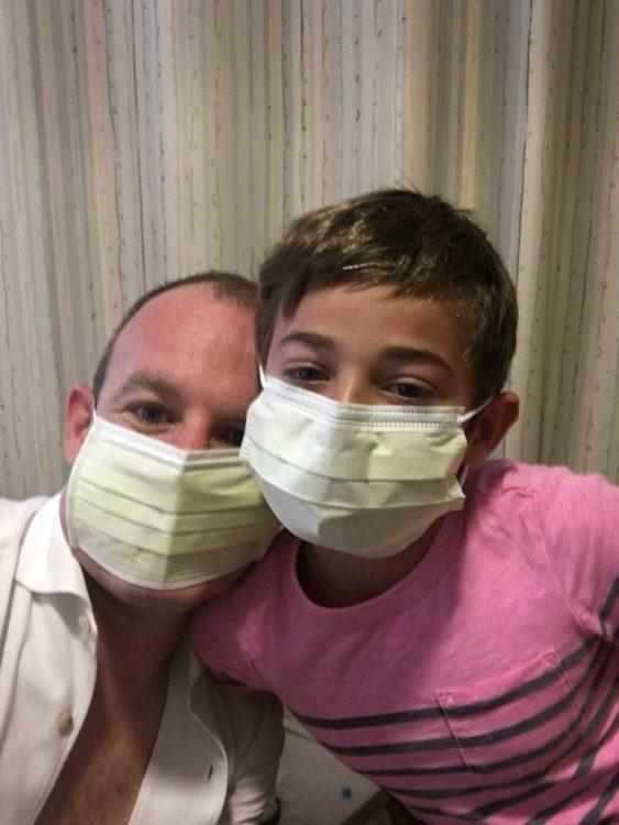 man and daughter wearing surgical masks