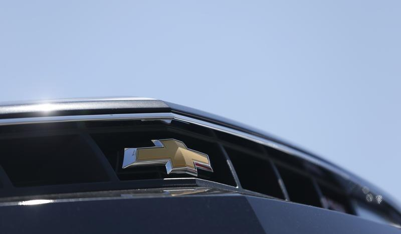 The Chevrolet logo is pictured on the front of a Chevrolet Camaro for sale at a car dealership in Los Angeles, California