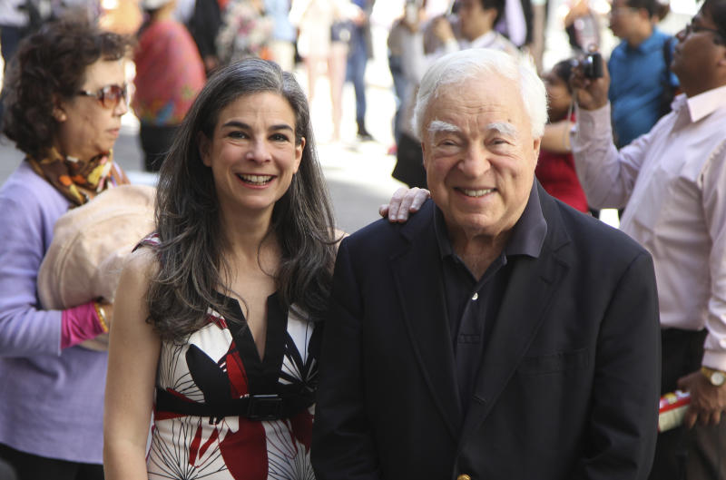 "This May 20, 2012 image shows Arthur Frommer, 83,  and his daughter, Pauline Frommer, 46, among the tourists in the Wall Street area in New York. The father-daughter team, host a live weekly call-in radio show together, called ""The Travel Show,"" on WOR-AM, which is carried on 115 radio stations across the U.S. (AP Photo/Seth Wenig)"