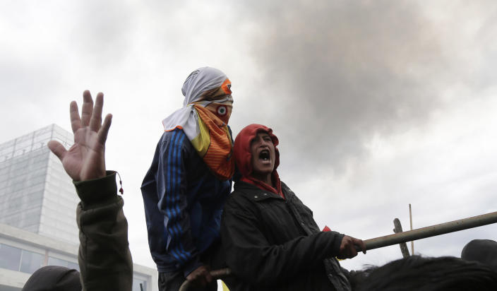Anti-government protesters clash with police near the National Assembly in Quito, Ecuador, Tuesday, Oct. 8, 2019. Protests, which began when President Lenín Moreno's decision to cut subsidies led to a sharp increase in fuel prices, has persisted for days, and clashes led the president to move his besieged administration out of Quito. (AP Photo/Dolores Ochoa)