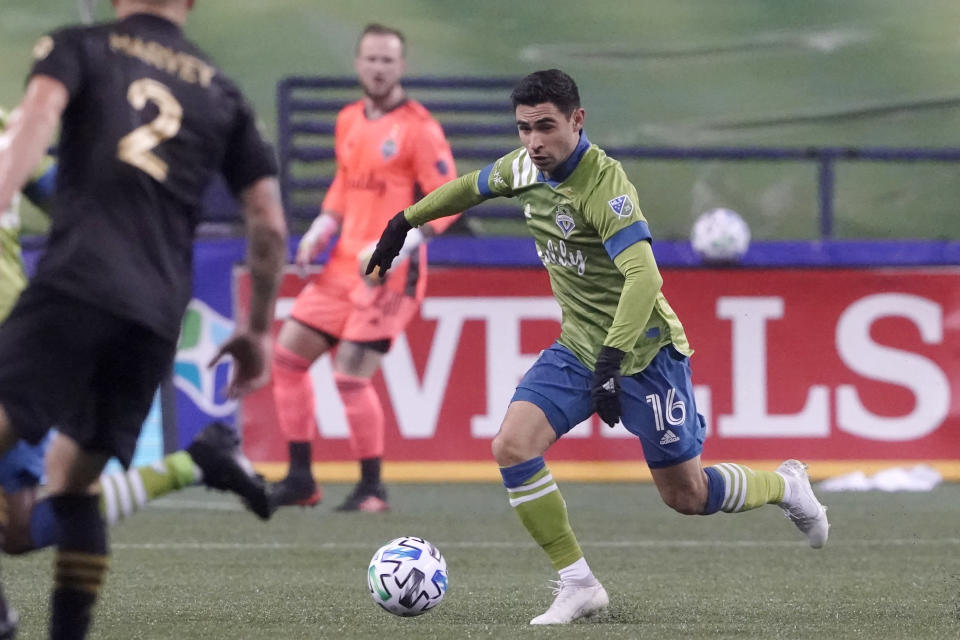 Seattle Sounders midfielder Alex Roldan (16) dribbles against Los Angeles FC during the first half of an MLS playoff soccer match, Tuesday, Nov. 24, 2020, in Seattle. (AP Photo/Ted S. Warren)