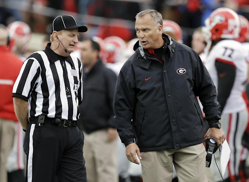 Georgia head coach Mark Richt argues with head linesman Gary Jayroe, left, in the fourth quarter of an NCAA college football game against Vanderbilt on Saturday, Oct. 19, 2013, in Nashville, Tenn. Vanderbilt upset No. 15 Georgia 31-27. (AP Photo/Mark Humphrey)