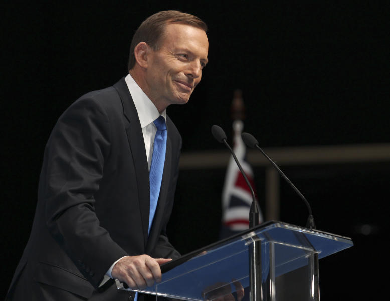 """FILE - In this Sunday, Aug. 25, 2013 file photo, Australian opposition leader Tony Abbott speaks to the crowd during the 2013 Coalition Campaign Launch in Brisbane, Australia. Abbott, the political pugilist who leads Australia's opposition, was once dubbed """"unelectable"""" by a former boss, but as the Sept. 7, 2013 elections near he seems certain to become prime minister. The 55-year-old conservative has never been very popular. His Liberal Party colleagues elected him their leader by just a single vote in 2009. """"Polarizing"""" is an adjective often used to describe him. (AP Photo/Tertius Pickard, File)"""