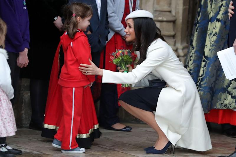 Meghan was pictured accepting a bouquet of flowers from a girl outside the church. Photo: Getty Images